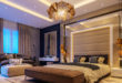Glamorous-bedroom-panelled-grey-headboard-origami-amber-feature-chandelier