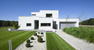 White-facade-with-groomed-lawns-and-waterless-garden-900x600
