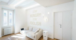 White-living-area-has-inspirational-phrases-on-its-feature-wall-900x600