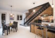 3-stories-apartment-remodel-features-exposed-brick-in-the-kitchen