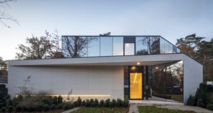 House-Z-M-uses-mirrors-to-blend-in-