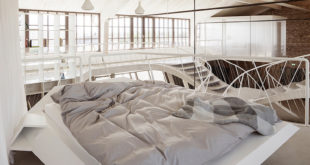 Reinvented-loft-in-Austria-platform-bed-and-graphical-railings
