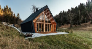 Wooden-House-set-in-a-large-frorest-clearing