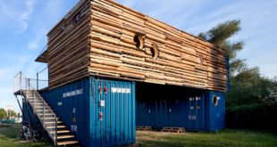 Shipping-container-hotel-with-closed-off-wood-facade