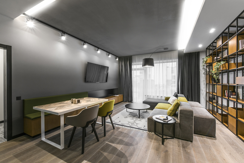 Vilnius-apartment-features-a-cozy-living-and-dining-area